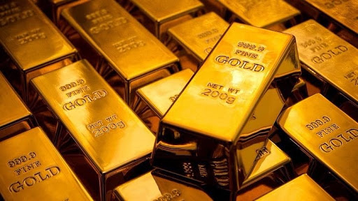 Gold slips from 3-week peak as dollar firms ahead of FED minutes